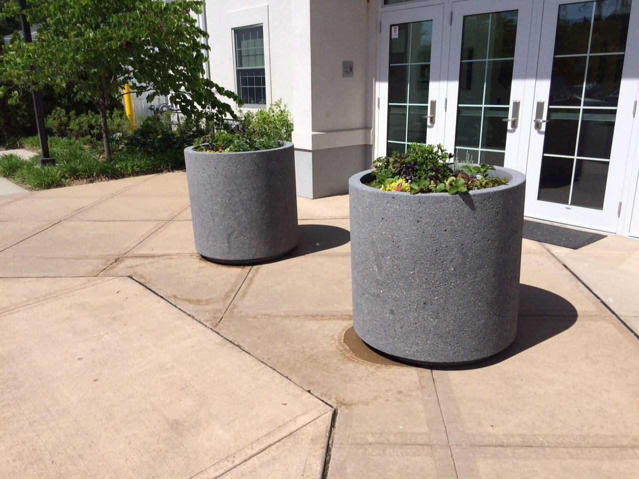 Round concrete planter w toe kick site furnishings Concrete planters